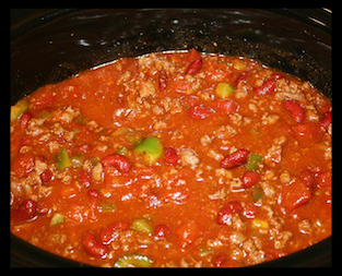 Slow Cooker Chili  INGREDIENTS:  1.	1 lb. ground beef 2.	2 cups diced tomatoes 3.	2 oz. tomato paste 4.	1 cup dark red kidney beans 5.	1 onion, chopped 6.	½ cup red and green peppers, chopped 7.	1 envelope chili seasonings 8.	1 clove garlic, minced 9.	1 tsp. chili powder 10.	Hot sauce to taste 11.	1 oz. dark chocolate  DIRECTIONS:  1.	Add all ingredients except beef to slow cooker 2.	(Get all the tomato paste out of can by adding water to the can) 3.	Break beef into small pieces and add to cooker 4.	Stir well  5.	Cook 6-8 hours on low heat  Serve with shredded cheddar and sour cream